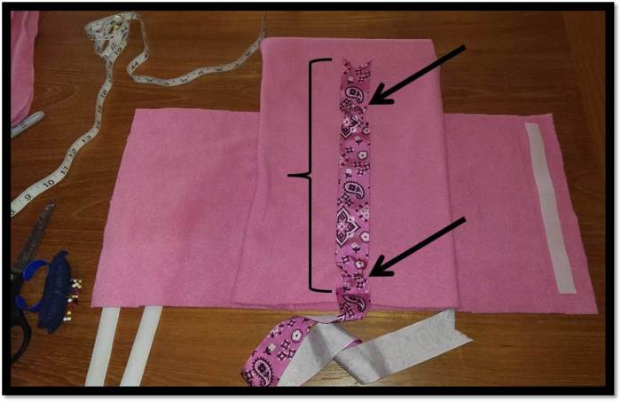 Attaching ribbon and key chains to dog coat