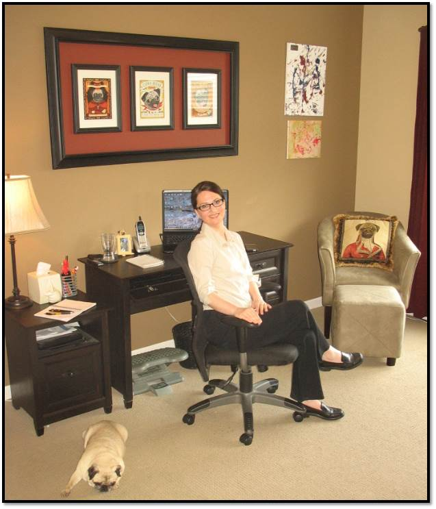 Arden Zich in home office with Peanut pug